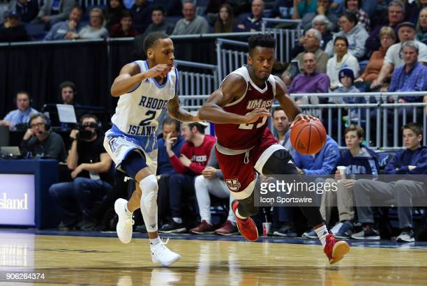 UMass Minutemen guard CJ Anderson drives past Rhode Island Rams guard Fatts Russell during a college basketball game between UMass Minutemen and...