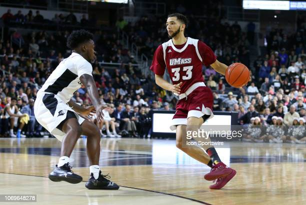 UMass Minutemen guard Curtis Cobb and Providence Friars guard Maliek White in action during a college basketball game between UMass Minutemen and...