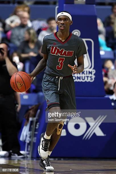 UMass Minutemen guard Dejon Jarreau dribbles the ball up court during the second half of an NCAA basketball game between UMass Minutemen and Rhode...