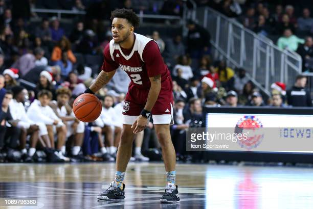 UMass Minutemen guard Luwane Pipkins in action during a college basketball game between UMass Minutemen and Providence Friars on December 7 at the...