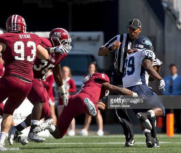 UMass Minutemen player Ed SaintVil cannot tackle Maine Black Bears running back Ricky Stevens en route to the end zone during the first half The...