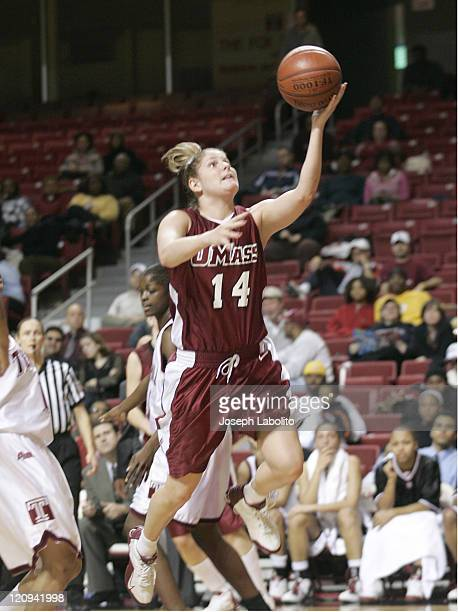 UMass Pam Rosanio drives the lane during a Temple Owls 59 to 43 victory over the University of Massachusetts Minutewomen at the Liacouras Ctr in...