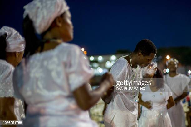 Umbanda faithfuls pray and dance to Iemanja the goddess of the sea from the ancient Yoruba mythology and one of the most popular deities of the...