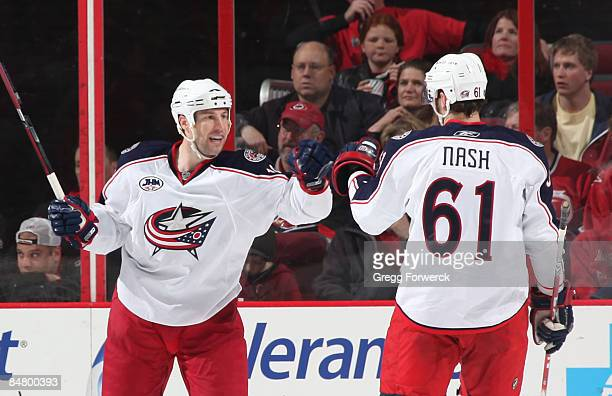 Umberger of the Columbus Blue Jackets celebrates his 2nd period goal with teammate Rick Nash during a NHL game against the Carolina Hurricanes on...