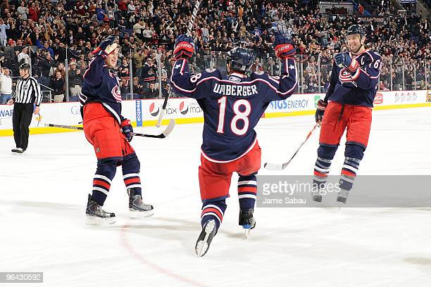 Umberger of the Columbus Blue Jackets celebrates his game-winning goal against the Dallas Stars with teammates Antoine Vermette and Rick Nash of the...