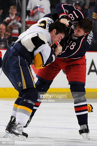 J Umberger of the Columbus Blue Jackets fights with Drew Stafford of the Buffalo Sabres during the third period on February 6 2010 at Nationwide...