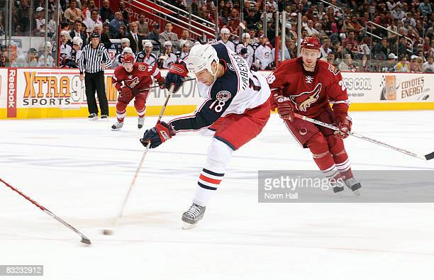 J Umberger of the Columbus Blue Jackets passes the puck during the third period on October 11 2009 at Jobingcom Arena in Glendale Arizona