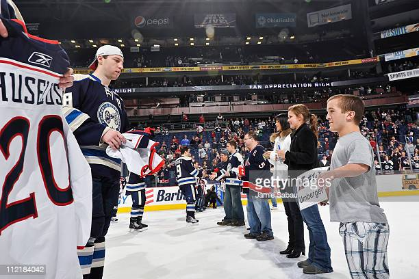 Umberger of the Columbus Blue Jackets prepares to give away one of his jerseys to a fan following the their season ending game against the Buffalo...