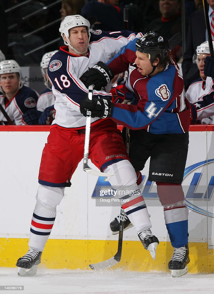 R.J. Umberger #18 of the Columbus Blue Jackets puts a hit on Ryan Wilson #44 of the Colorado Avalanche at the Pepsi Center on March 1, 2012 in Denver, Colorado.