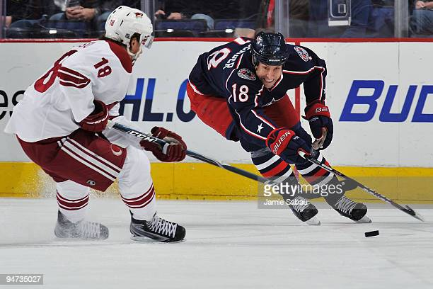 Umberger of the Columbus Blue Jackets reaches to try and take control of the puck away from Sami Lepisto of the Phoenix Coyotes during the first...