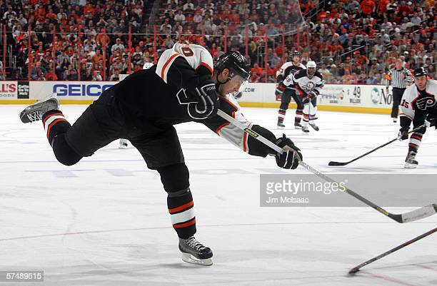 J Umberger of the Philadelphia Flyers scores an unassisted goal in the third period against the Buffalo Sabres in game four of the Eastern Conference...