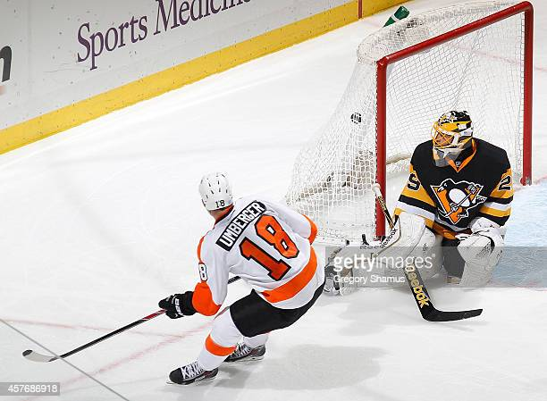 J Umberger of the Philadelphia Flyers scores past MarcAndre Fleury of the Pittsburgh Penguins during the third period at Consol Energy Center on...