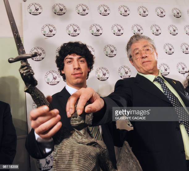 Umberto Bossi populist Northern League leader and his son Renzo poses with the symbol of their party an 'Alberto Da Giussano' statue at the end of a...