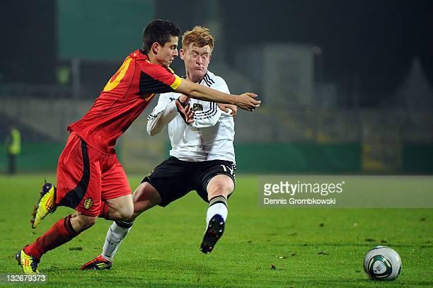 Umberto Carvalho Dos Santos of Belgium is challenged by Sebastian Kerk of Germany during the U18 International Friendly match between Germany and...