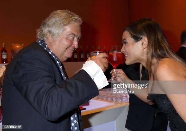 """Umberto Contarello and Pina Turco of the movie """"Il Vizio Della Speranza"""" are seen at the Campari Red Room during the 13th Rome Film Fest at..."""