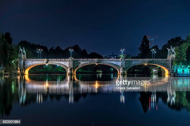 Umberto I Bridge in Turin and Po river by night