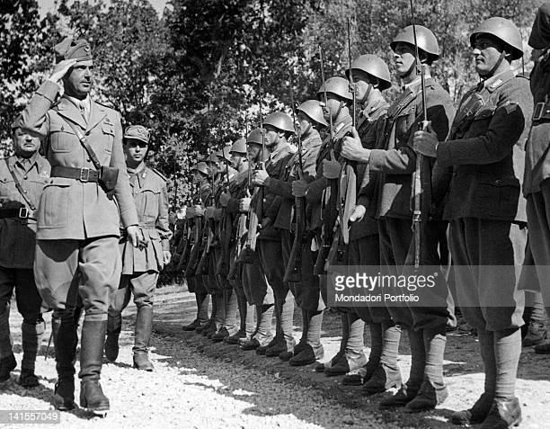 Umberto II Prince of Savoy review a Carabinieri unit standing to attention Italy May 1944
