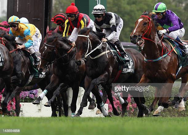 Umberto Rispoli of Italy riding Rulership competes before winning the 2012 Audemars Piguet Queen Elizabeth II Cup horse race at the Sha Tin...