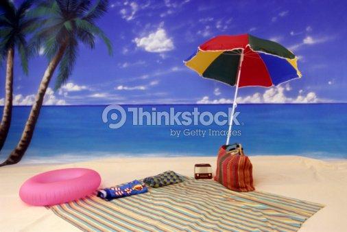 Umbrella And Blanket On Beach Stock Photo