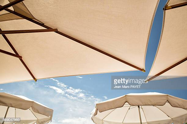 umbrella and blue sky - jean marc payet stock pictures, royalty-free photos & images