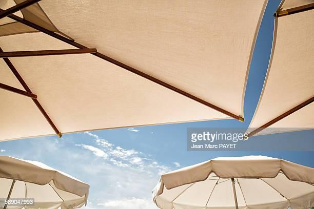 umbrella and blue sky - jean marc payet stockfoto's en -beelden