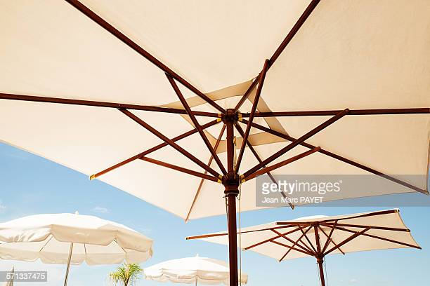 umbrella and blue sky - jean marc payet stockfoto's en -beelden