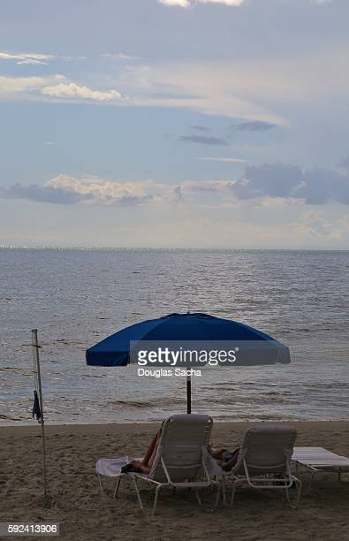umbrella and lounge chairs on the beach, siesta beach, don pedro island state park, placida, florida, united states - siesta key stock photos and pictures