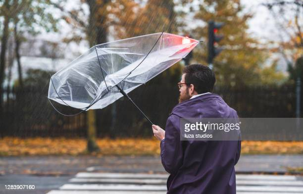 umbrella caught in the wind - wind stock pictures, royalty-free photos & images