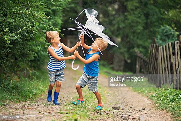 Umbrella malfunction - two boys with broken umbrella