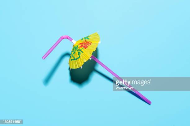 umbrella parasol drinking straw on blue pool background - cocktail party stock pictures, royalty-free photos & images