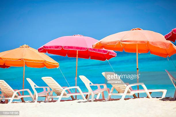 Umbrellas and lounge chairs on a Caribbean beach