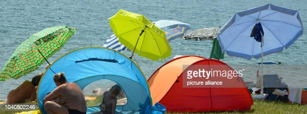 Umbrellas and tents stand in a nudist section at Lake Moritzsee near Leipzig Germany 08 June 2014 Photo WALTRAUD GRUBITZSCH/dpa   usage worldwide