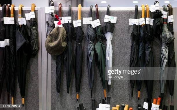 Umbrella's are hung in a cloakroom on the third day of the Conservative Party Conference at Manchester Central at Manchester Central on October 01...