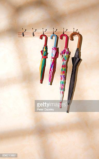 Umbrellas on a coat rack with copy space
