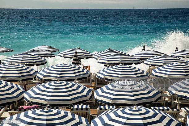 umbrellas on the beach in nice - jean marc payet stockfoto's en -beelden