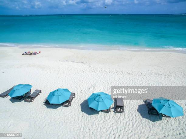 umbrellas on the beach - turks and caicos islands stock pictures, royalty-free photos & images