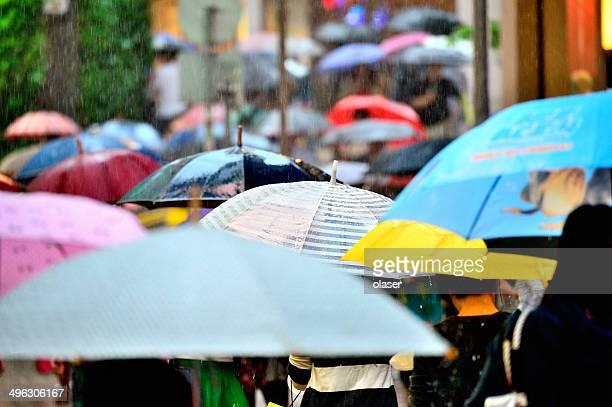 Umbrellas over crowd, Hong Kong city