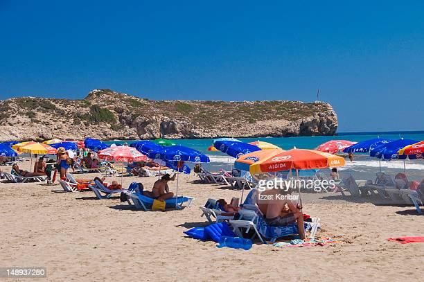 Umbrellas, sun-lounges and beachgoers on Patara Beach.
