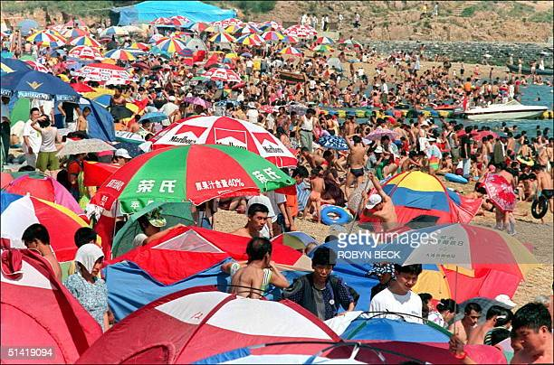 Umbrellas tents and bodies crowd a popular beach in Dalian 19 July Dalian which at various times in the last century has been taken as colonial bases...