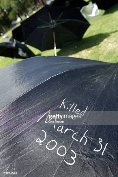 Umbrellas that are decorated with words from family friends and others are setup to represent people killed in Iraq June 8 2004 in Savannah Georgia...