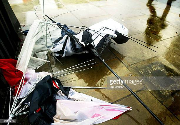 Umbrellas wrecked by strong winds lie abandoned on Westminster Bridge January 8 2004 in London High winds and torrential rain has battered the South...