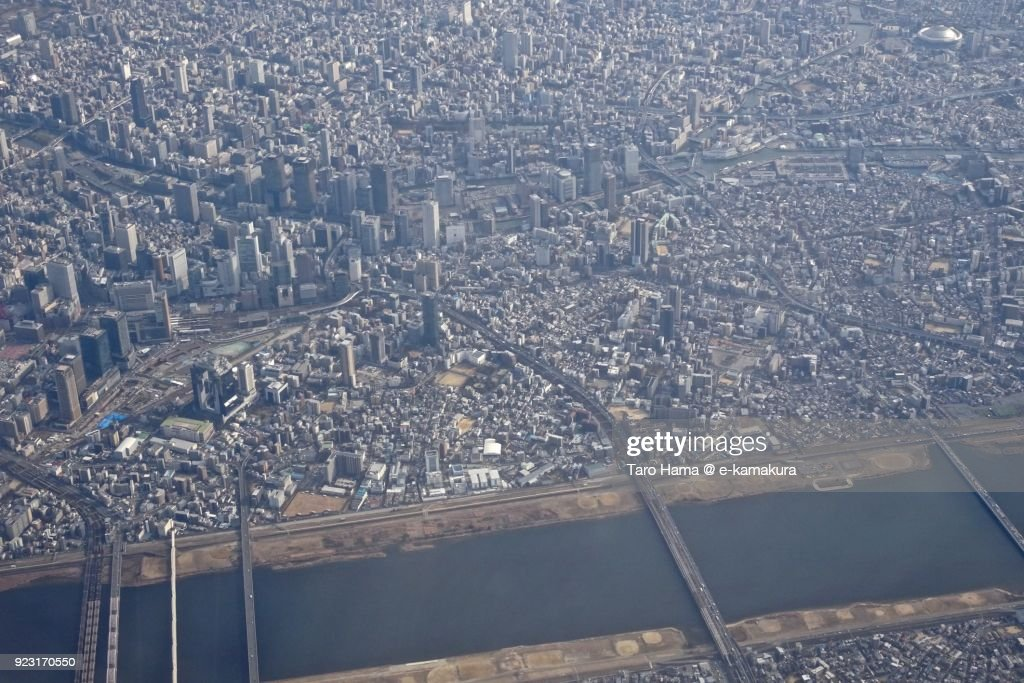 Umeda area and Yodo River in Osaka city in Osaka prefecture in Japan daytime aerial view from airplane : Stock-Foto