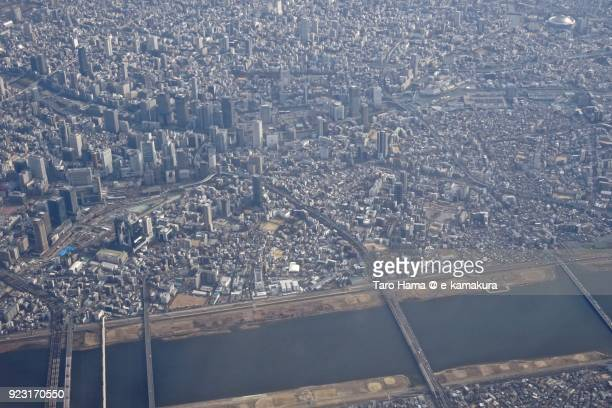 umeda area and yodo river in osaka city in osaka prefecture in japan daytime aerial view from airplane - präfektur osaka stock-fotos und bilder