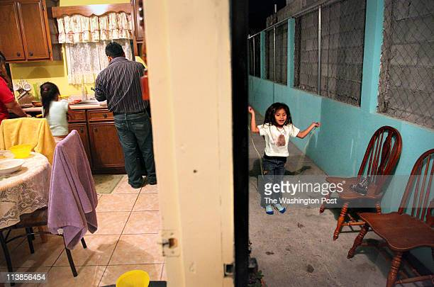 Umeko Perdomo right plays outside the Perdomo family home in Matamoros Mexico while her family prepares dinner inside Princess Martinez's six...