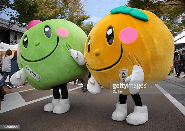 Umeppi and Mikappi the mascots of plums and mandarin oranges of Wakayama prefecture are seen during the Yuru Chara Festival in Hikone at Yumekyobashi...