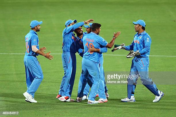 Umesh Yadaav of India celebrates with teammates after he got the wicket of Sohaib Maqsood of Pakistan during the 2015 ICC Cricket World Cup match...