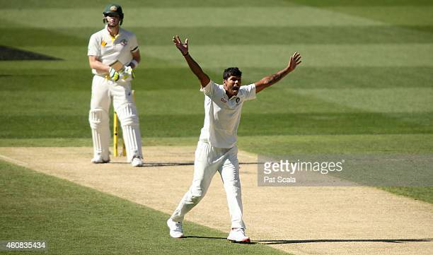 Umesh Yadav appeals unsuccessfully for the wicket of Steve Smith during day one of the Third Test match between Australia and India at Melbourne...