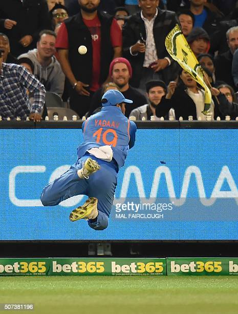 Umesh Yadav of India attempts a catch during during the second Twenty20 international cricket match between Australia and India at the MCG in...