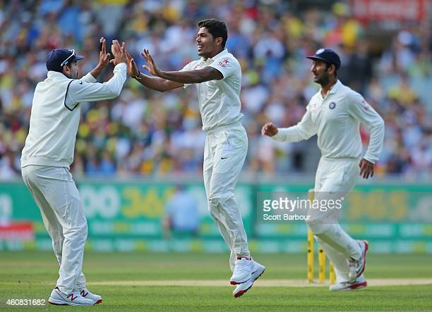Umesh Yadav of India celebrates after dismissing David Warner of Australia during day one of the Third Test match between Australia and India at...