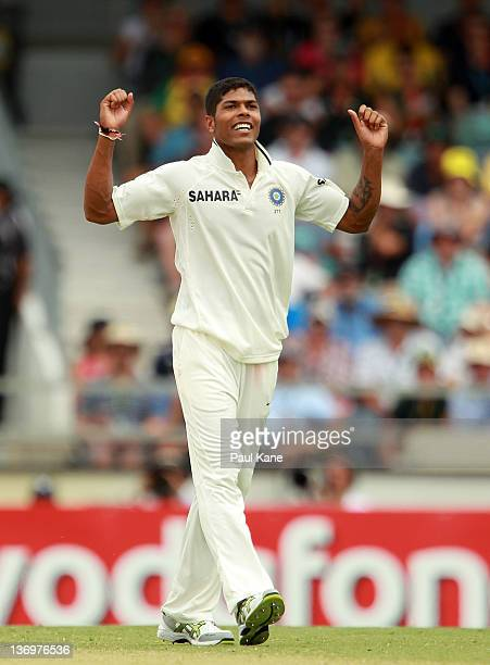 Umesh Yadav of India celebrates dismissing Ryan Harris of Australia and taking his fifth wicket during day two of the Third Test match between...